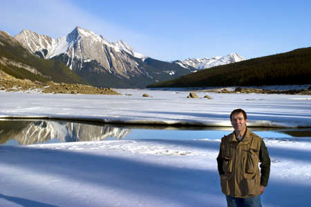 fifty something: Man standing in front of Medicine Lake, Alberta, Canada Stock Photo
