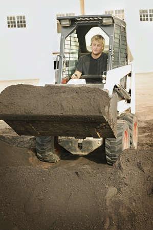 Man operating small digger Stock Photo - 7207280