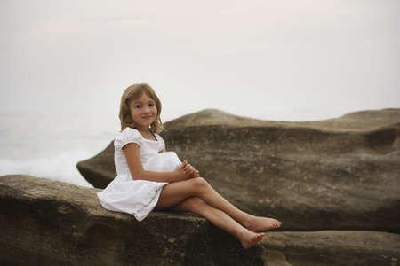 glubish: Girl posing on a large rock