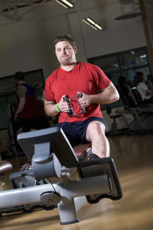 Man working out in a gym Stock Photo - 7207281