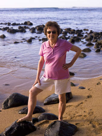 50 something fifty something: Woman at the beach, Kauai, Hawaii, USA