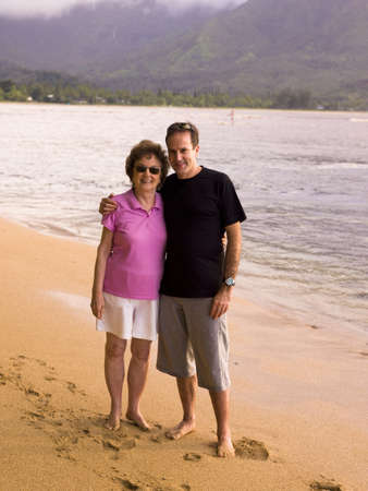 seventy something: Couple on beach in Kauai, Hawaii, USA Stock Photo
