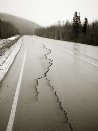 damaged: Road with cracks