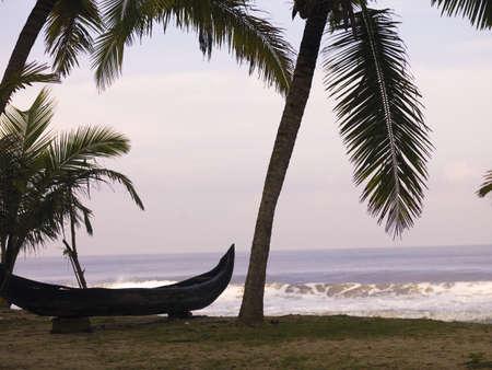 Canoe on the beach, Arabian Sea, Kerala, India   photo