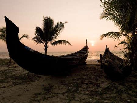 Two canoes on the beach at the Arabian Sea, Kerala, India   photo