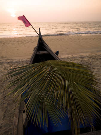 A canoe on the beach at the Arabian Sea, Kerala, India   photo