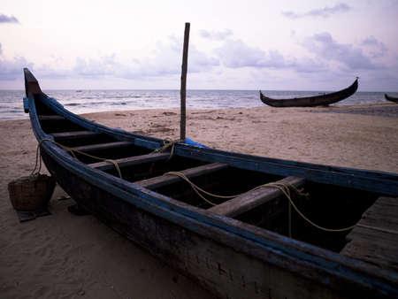 Boats on shore, Arabian Sea, Kerala, India photo