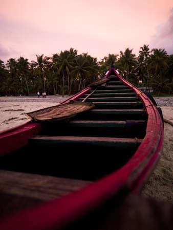 Boat on the beach at the Arabian Sea, Kerala, India   photo