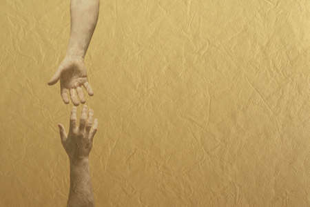 Two hands reaching towards each other