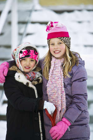 carson ganci: Portrait of two girls in winter clothes Stock Photo