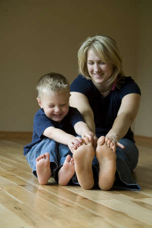 family unit: Mother and son playing on the floor