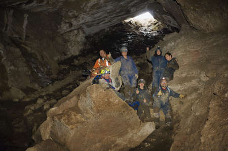 fifty something: Climbers cheering in cave,Cadomin,Alberta,Canada Stock Photo