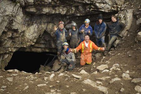 Climbers cheering outside cave,Cadomin,Alberta,Canada