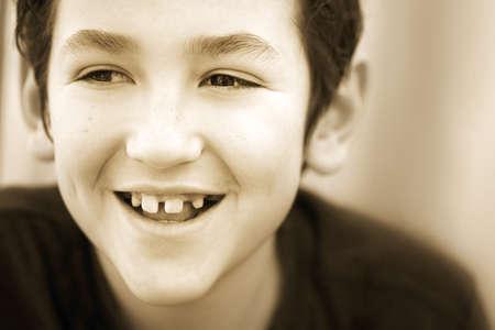 sepias: Portrait of boy smiling Stock Photo