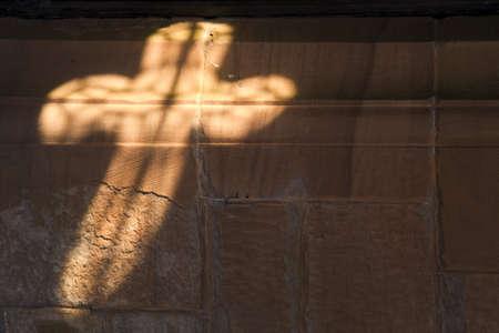 Light in cross shape on wall Stock Photo - 7206585