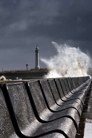 Waves crushing against barrier,Sunderland,Tyne and Wear,England photo