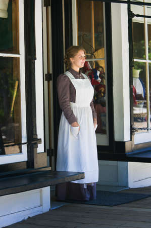 Young woman standing in store doorway