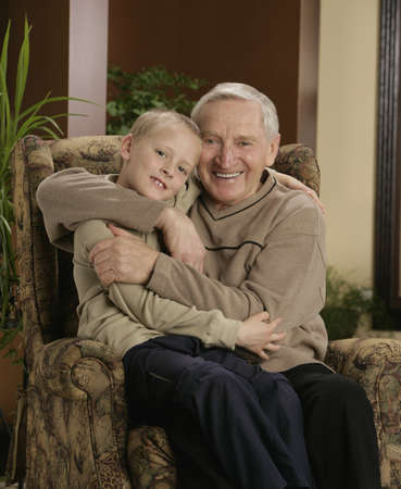 sixty something: Grandfather hugging grandson