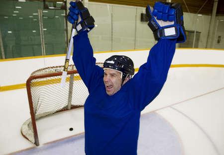Hockey player celebrating a goal photo
