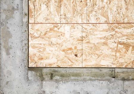 fullframes: Corner piece of wood encased in concrete