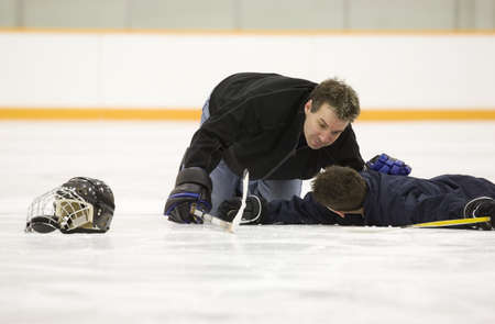 Hockey player down on the ice photo