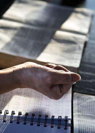 bookish: Hand holding something