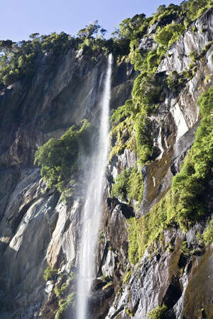 Waterfall in Milford Sound,New Zealand photo