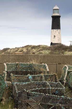 nautical structure: Lighthouse and lobster traps,Humberside,England Stock Photo