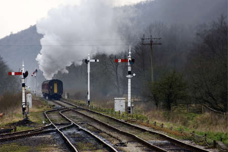 signalling: Train on railroad tracks,Grosmont,North Yorkshire,England