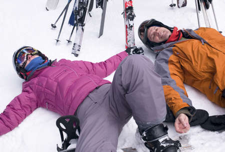 wintersports: Two skiers resting in the snow,Whistler,BC,Canada