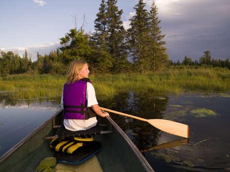 rowing boat: Girl canoeing