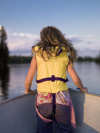lifejacket: Girl in the front of a boat