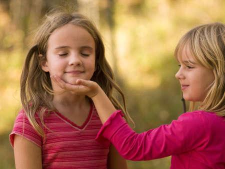 Two girls playing   Reklamní fotografie