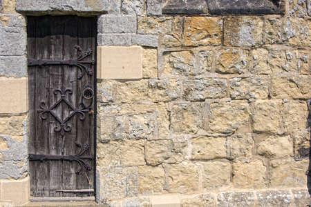 Ornate door,stone wall photo