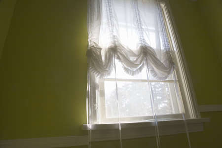 window curtains: Window with sheer curtains