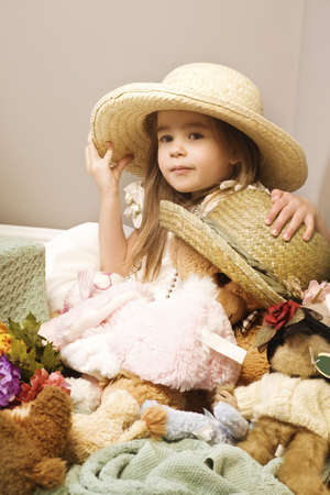 elementary age girls: Girl and teddy bear wearing straw hats