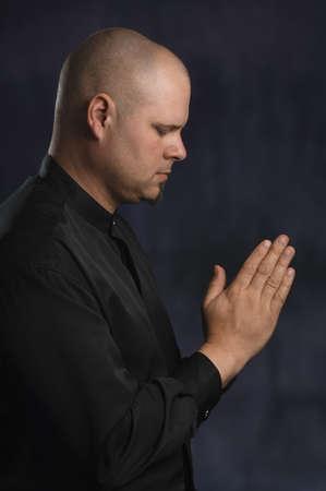 intercessory prayer: Man Praying Stock Photo