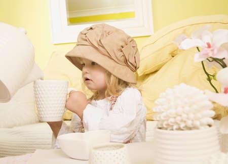 Girl holding mug