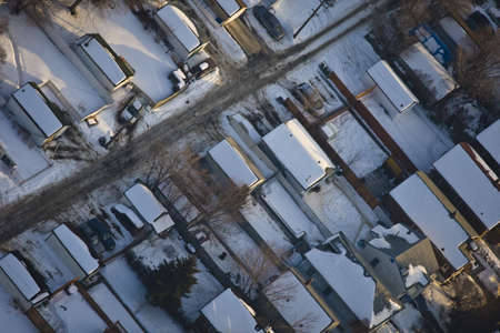 arial views: Snow covered houses in residential suburb