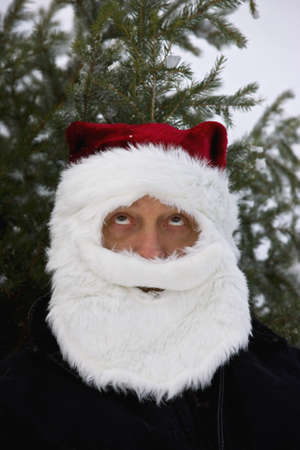 50 something fifty something: Man dressed as Santa Claus