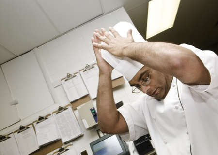 50 something fifty something: Chef putting hat on