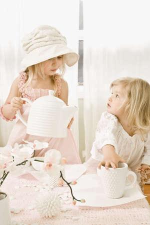 Two girls having a tea party Foto de archivo