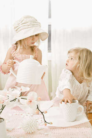 tea hot drink: Two girls having a tea party Stock Photo