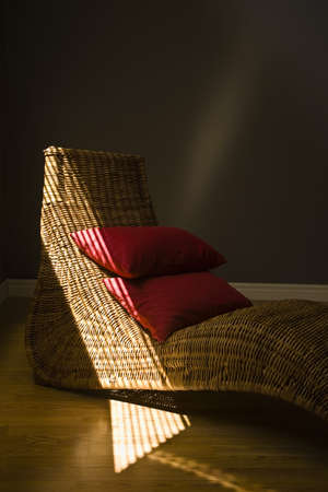 Wicker lounging chair with red pillows Stock Photo - 7210847