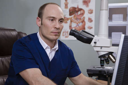 50 something fifty something: Man and microscope Stock Photo