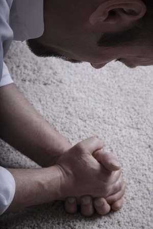 bowing head: Praying man