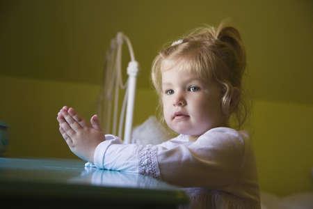Young girl praying photo