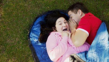 eyecontact: Couple in a sleeping bag Stock Photo