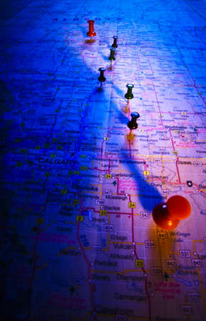 Thumb tacks on a map photo