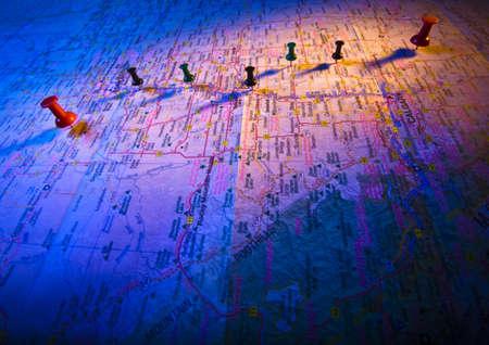fullframes: Thumb tacks on a map Stock Photo